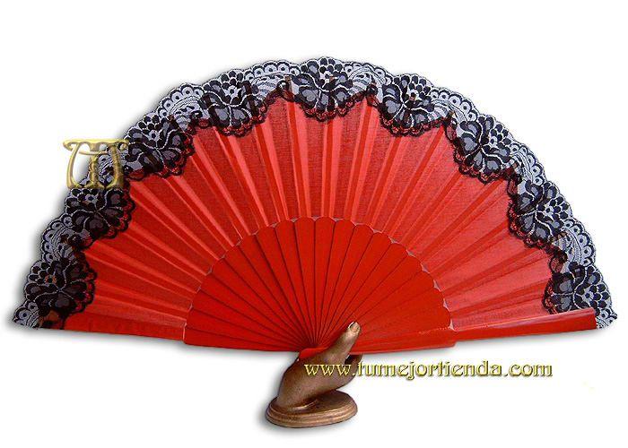 Bello abanico rojo con encaje negro