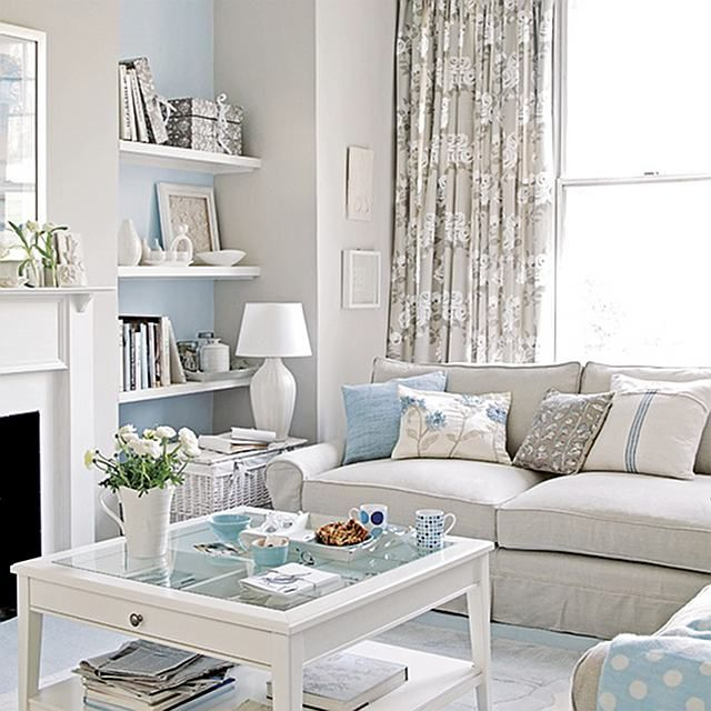 like the blue accent wall on sides  of fireplace with bookshelves