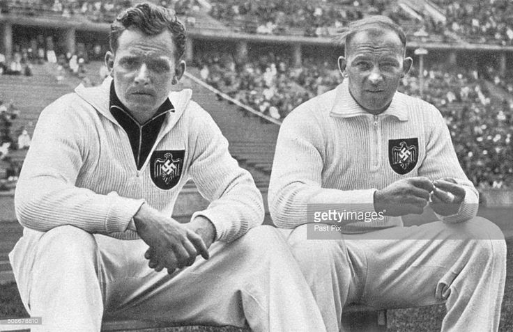 Berlin Olympics - 1936, Karl Hein and Erwin Blask, the two strong German athletes who won Gold and Silver medals in the hammer throw with record distances.