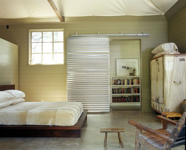 Corrugated metal hanging door; Mell Lawrence Architects. I'd love to replace the jack and jill bath doors with this barn door.