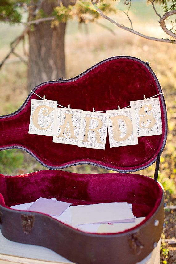 Cards banner for wedding cards table or container. Vintage music sheet background with metallic antique gold cardstock letters. Clipped onto cord with tiny clothespins. Letters measure 4 inches, music sheet rectangles are about 5 and 5/8 inches by 4 and 1/2 inches each.  #timelesstreasure