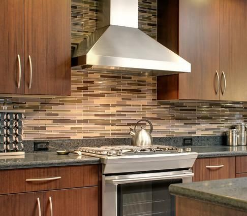 Also loving this backsplash! -Thin Asymmetrical Glass Tile (design by RemodelWest, photo by Scott Dubose)
