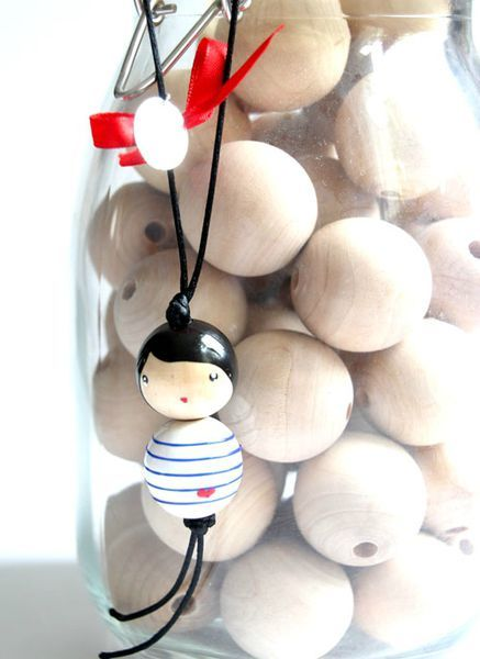 DIY doll necklace out of wooden pearls