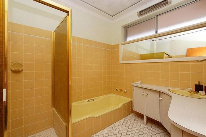 60's home, mid century modern, yellow bathroom