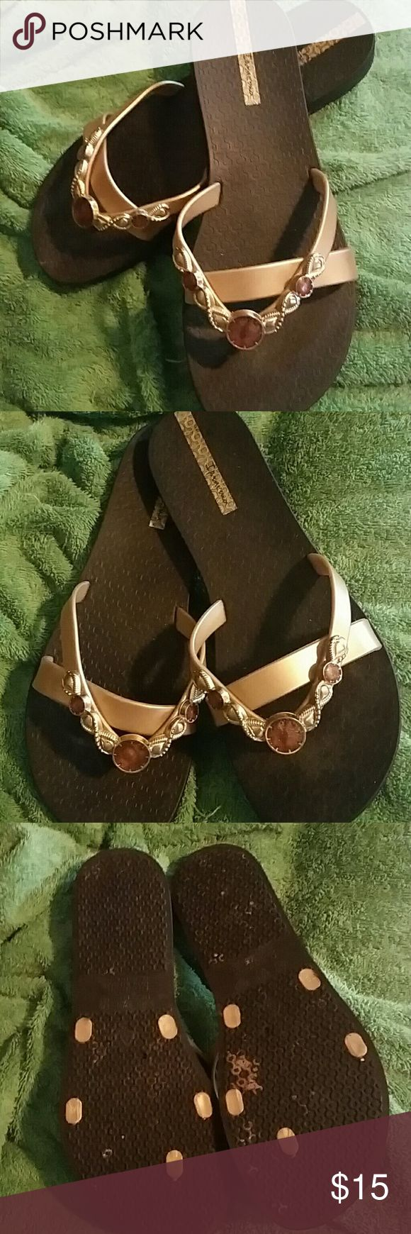 Ipanema Brown & Gold Dressy Flip Flops Gently used. Will be cleaned and sterilized upon purchase. Gold & brown colors with details great for dressing up any outfit. Very comfortable wear. Made in Brazil. Size 8-9. Pet friendly home. Ipanema  Shoes Sandals