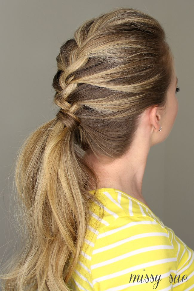 This pretty braided pony is great for a day at the office or a night out, especially when you're rocking day-two hair. Start the braid at the crown of your head, and braid until you reach your preferred ponytail height. Secure it with an elastic, and tease your pony. For the full instructions, visit Missy Sue.