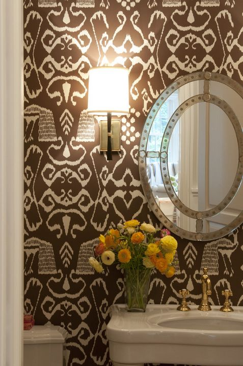 designer powder room with wallpaper