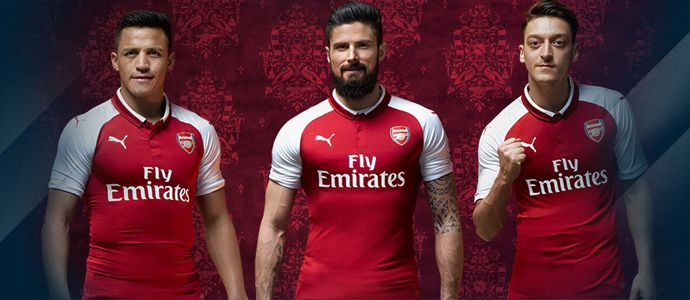 Arsenal and PUMA have revealed their new 2017/18 home kit in a 'live activation' at Kings Cross station in London where fans can come and take pictures with the FA Cup in a specially designed area. From http://www.soccerjerseysgb.com/arsenal-football-club/2017-18-home-jerseys.html