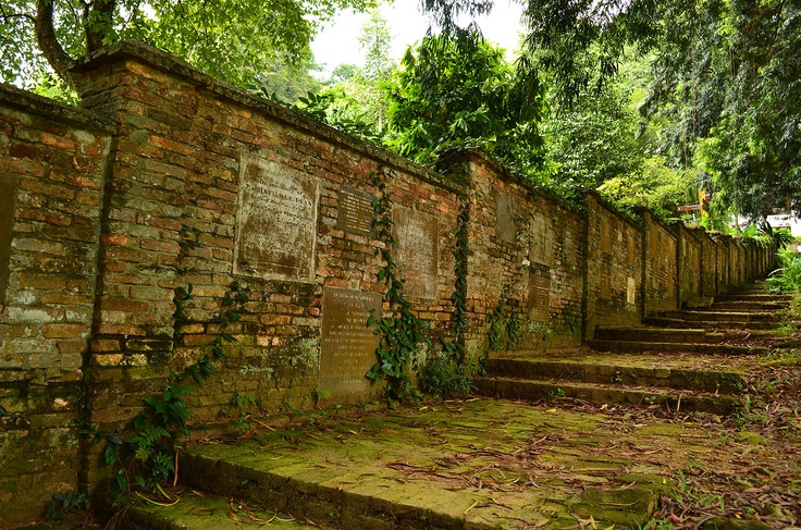Fort Canning Park, A picture taken in Fort Canning Park. These walls are made up of tombstones.   here used to be an old christian cemetry until 1865, after that most of the tombstones were removed and set into the wall surrounding Fort Canning Green.