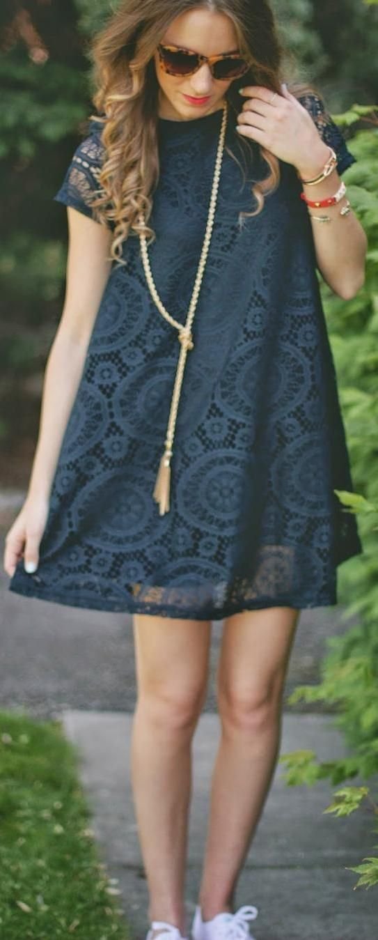 I love the fit and style of this dress, and the gold tassel necklace is perfect with it!