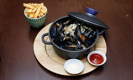 Pot luck: mussels and chips. Photograph: Katherine Rose for the Observer