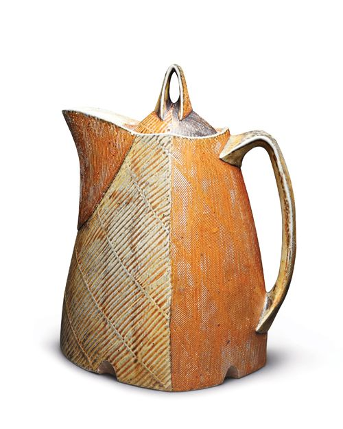 Bill Wilkey's Two-quart lidded juice pitcher, 13 in. (33 cm) in height, wheel-thrown, altered, and handbuilt porcelaneous stoneware, flashing slips, glazes, soda fired to a hot cone 10, 2013. This originally appeared in the May 2014 issue of Ceramics Monthly. Wilkey was one of Ceramics Monthly's 2014 Emerging artists. To learn more, click here: http://ceramicartsdaily.org/ceramics-monthly/ceramics-monthly-may-2014/