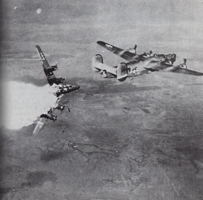 """Direct hit on B-24 A heavy US bomber B-24 """"Liberator"""" took a direct hit of german flak and breaks apart."""