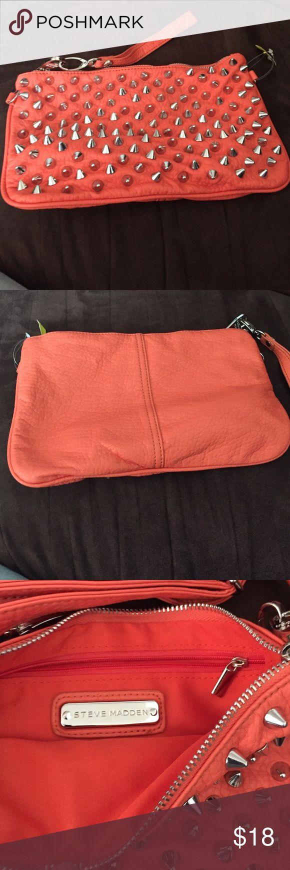 Steve Madden orange clutch/ shoulder bag. Steve Madden orange clutch. Has strap which makes this bag versatile. Can be used as a shoulder bag or cross body bag. Steve Madden Bags Crossbody Bags