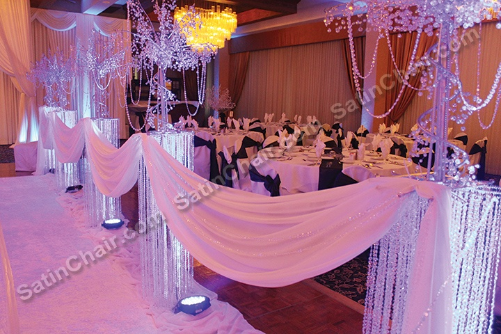 Lighted Crystal Column Pillars And Tree Accents Make For A Wonderful Wintery Wedding Ceremony