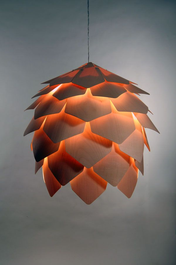 Pine Cone Pendant Lamp | Design Pavel Eekra | The semitransparent veneer lamp mimics the shape of the pine cone and creates a soft and inviting glow | Each of the 56 thin overlapping scales made of natural maple are held together with a single screw hidden beneath the preceding scale, adding to it's organic and clean form without the need for an internal skeleton