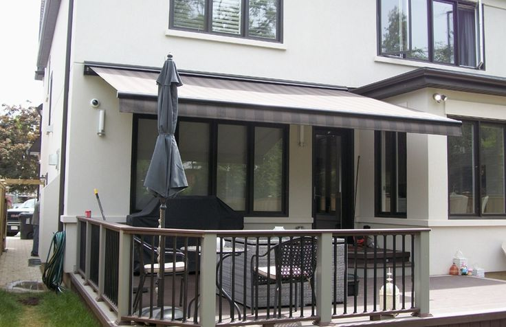 Rolltec Awning over a deck #Rolltec #DeckandPatio #awnings #landscaping
