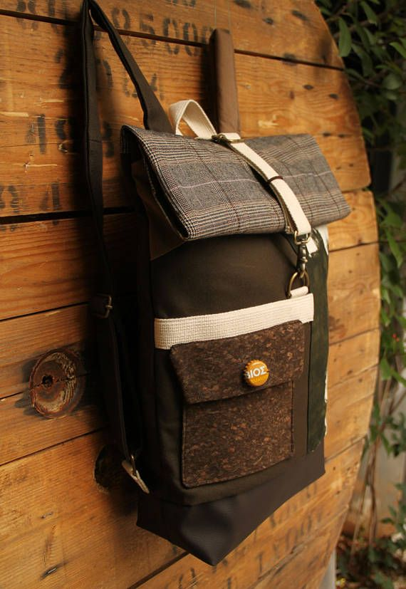 Beige and olive green roll top backpack using cork fabric for the front pocket and a beer cap as a decorative button, by 'eating the goober'