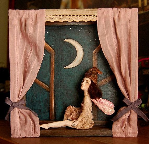 "Shadow box art doll sculpture. Cristina Grueso ""this is a one of a kind shadow box made by me. The fairy doll is sculpted out of polymer clay and measures 4 inches high in her sitting position. The wooden window measures 8""x8""."