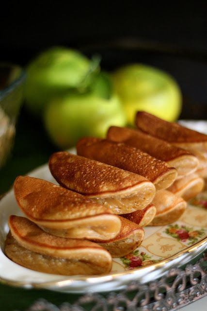 """Apam balik. Also called """"Terang Bulan"""" in some states, is a rich pancake-like dish slathered with liberal amounts of butter or margarine, and sprinkled with sugar, coarse nut and sometimes corn."""