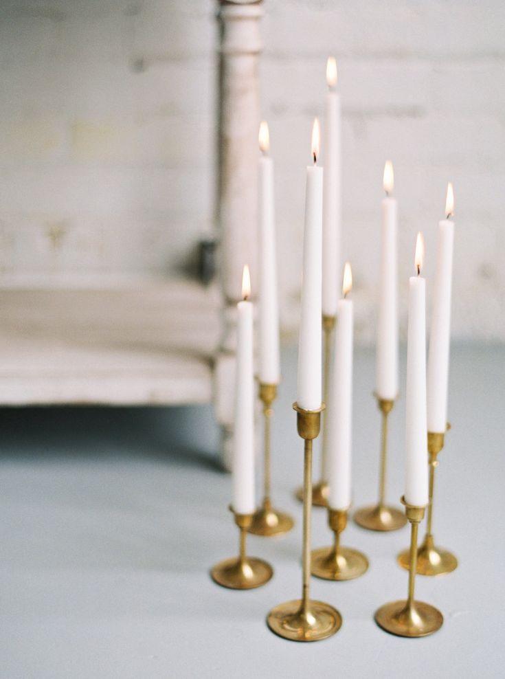 Modern candle decor: Event Planning + Design: Gigi Mallatt Events - http://www.stylemepretty.com/portfolio/gigi-mallatt-events Photography: Kristine Herman Photography - www.kristineherman.com/   Read More on SMP: http://www.stylemepretty.com/2017/03/27/modern-warehouse-wedding-ideas/