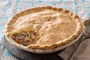 My go-to chicken pot pie recipe. Easy, quick family favorite. Use pie crust only on the top. Key ingredients: cream cheese, pie crust, Italian dressing, chicken (can be leftover chicken from other dish, or cut up rotisserie chicken), soup base, flour, veggies of your choice. Preheat oven to 375 F.