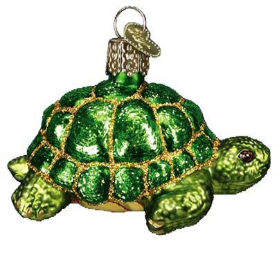 """Desert Tortoise Turtle Christmas Ornament 12198 Merck Family's Old World Christmas Ornament measures approximately 2"""" x 3"""" and is made of mouth blown, hand painted glass. In the story"""