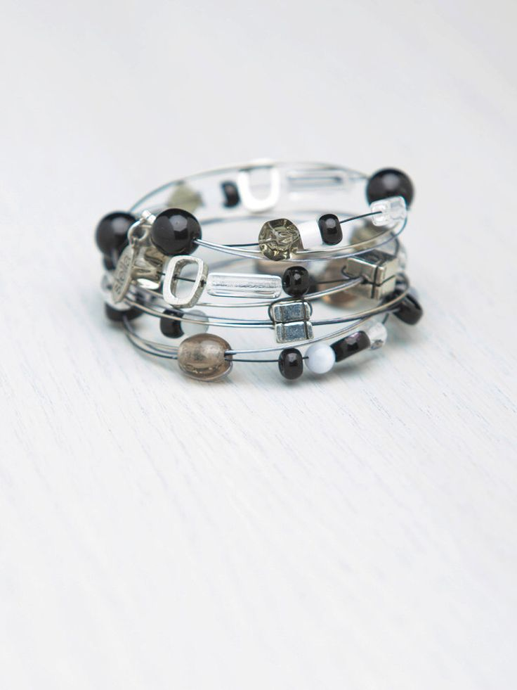 Black, Clear, Grey, Spiral Wrap Bracelet, Multi Strands, Stainless Steel wires, Glass Beads, Pewter, semiprecious Stones. by StellaIsabelDesy on Etsy https://www.etsy.com/ca/listing/210882208/black-clear-grey-spiral-wrap-bracelet
