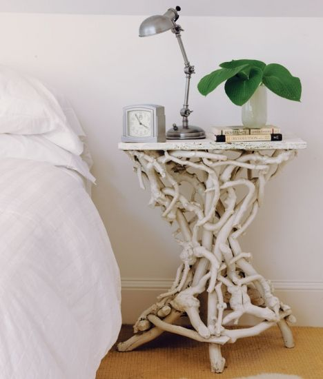 Branching Out | This small bedside table is crafted of intertwined twigs and branches painted white, lending a distinctly organic feel to a bedroom.