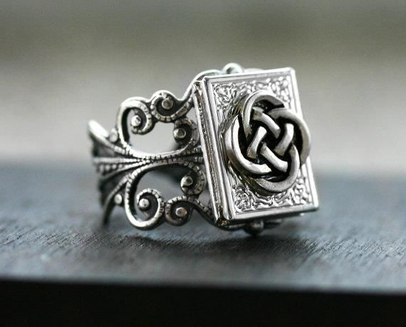 Wouldn't this be nice in the Lia Sophia collection!  Celtic Love Knot Book Locket Ring