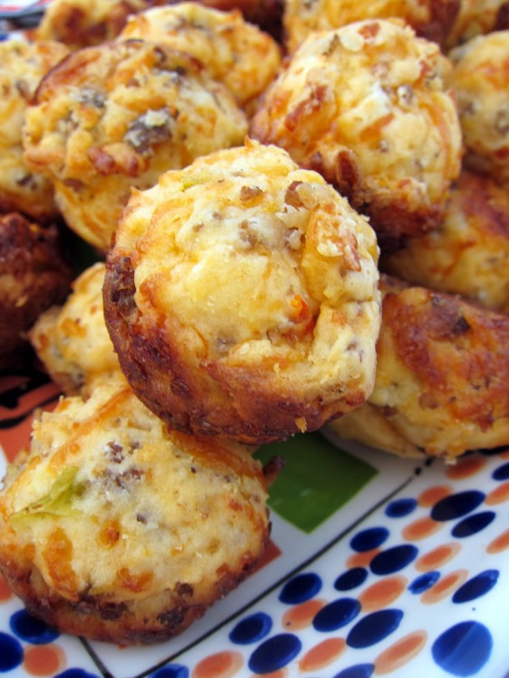 Sausage-Cheese-Muffins  1 lb. hot ground pork sausage  1 tsp onion powder  3 cups all-purpose baking mix  1 (10.75 oz) can nacho cheese soup  2 cups shredded Cheddar cheese  3/4 cup buttermilk (water or milk will work too)