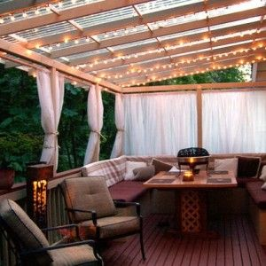 Beautiful! lighting - string lights - summer #porch and #patio decor, design ideas and inspiration  I'm not in love with the furniture, but I love the space. I had a curtained porch once, made it into a private outside room when they were pulled.