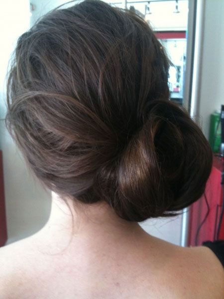large side chignon. looks a lot less fiddly than those tight ones. and good for long hair!