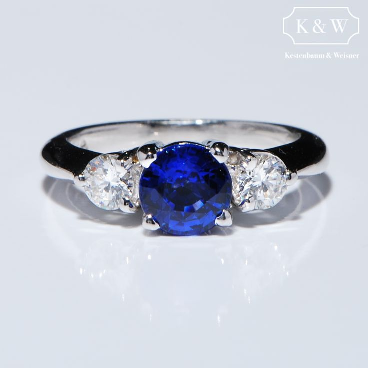 A beautiful Blue #Sapphire flanked by White Diamonds!