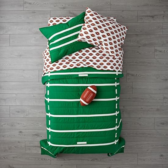 The Land of Nod Football Bedding is so great, it's ready to go pro. Made from comfy 100% cotton, the quilt is uniquely designed to resemble a green football field. And the printed sheet set is made from 100% organic cotton.