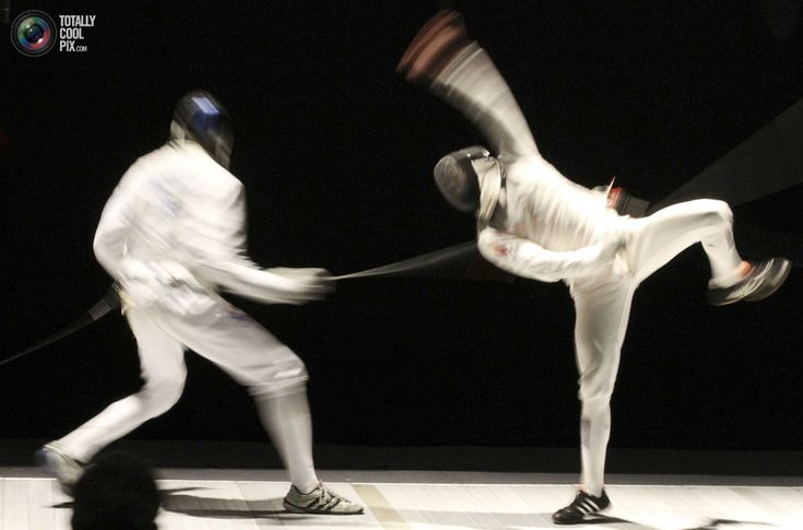 97. Gerek Meinhardt of the U.S. (L) competes against Venezuela's Cesar Bru during the men's fencing team florete finals at the Pan American Fencing Championships in San Jose August 6, 2010. The U.S. team won the gold medal. REUTERS/Kent Gilbert