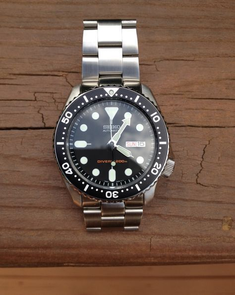 seiko skx007 modded with a super oyster bracelet and domed crystal. WANT!