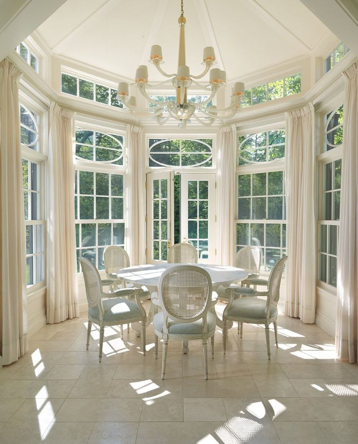 Dering Hall This Breakfast room is so light and airy that I can just imagine feeling the breeze coming through the open French Door. The tall ceiling, expansive detailed windows, marble floor and french cane back chairs are enchanting. I can easily see having a bridal breakfast here. I love the soft white colors.