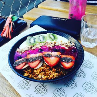 This pretty bowl of power is packed with either dragon fruit or acai, coconut-infused yoghurt, mango, kiwifruit, strawberries, blueberries, banana, chia seeds, granola, and hazelnut crumb. Um, yum.