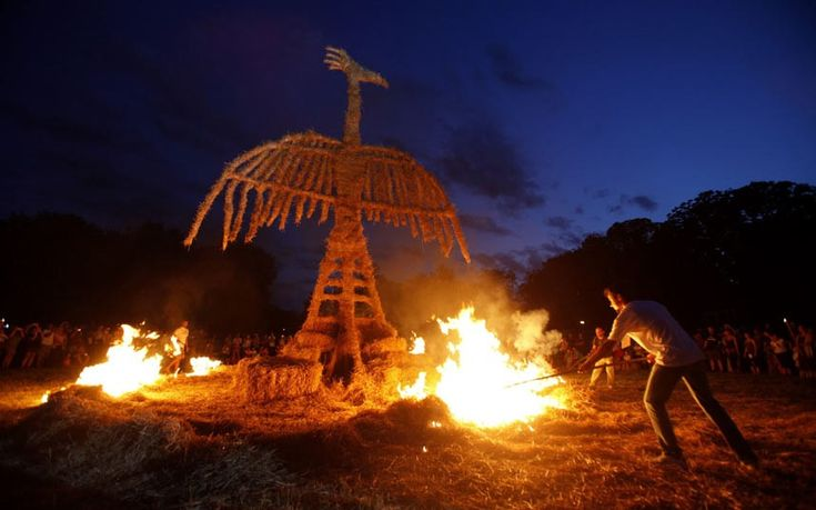 Artists burn a 10 meter high straw art installation of a phoenix during the 7th Straw - Land Art Festival in Osijek east Croatia, July 15, 2012. Twenty artists from Croatia, Bosnia and Herzegovina, Germany, Hungary, Slovakia and Mexico made 20 art installations using 30 tons of straw. REUTERS/Antonio Bronic