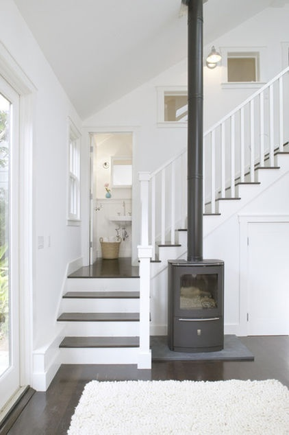 Creatively placed. Your freestanding fireplace doesn't have to be a focal point, and it doesn't have to be in any particular room, either. This foyer fireplace invites visitors to get warm as soon as they walk in. Tip: A fireplace in the entry or foyer is a great way to dry winter boots, hats and mittens in colder weather.