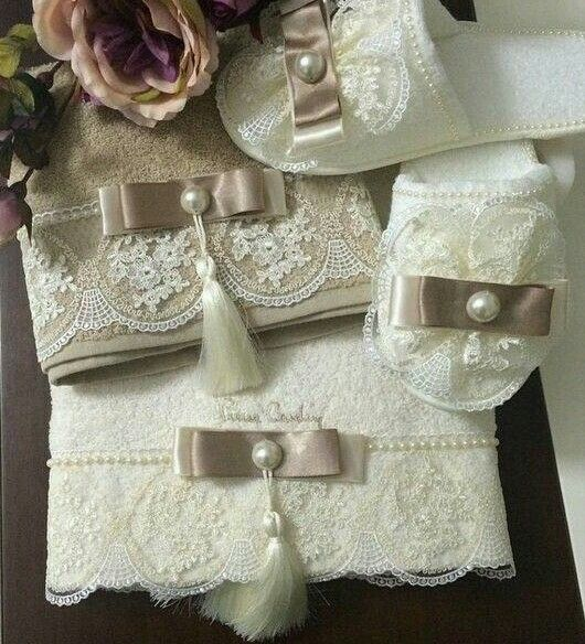 towels embellished with tassles, brown ribbon and lace