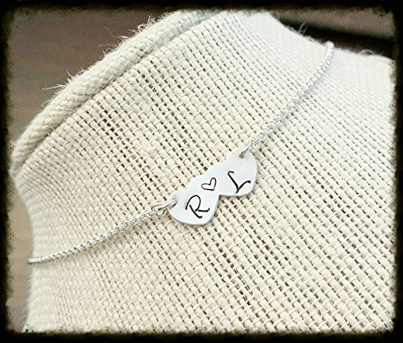 Check out this item in my Etsy shop https://www.etsy.com/listing/290134263/sterling-silver-double-heart-necklace
