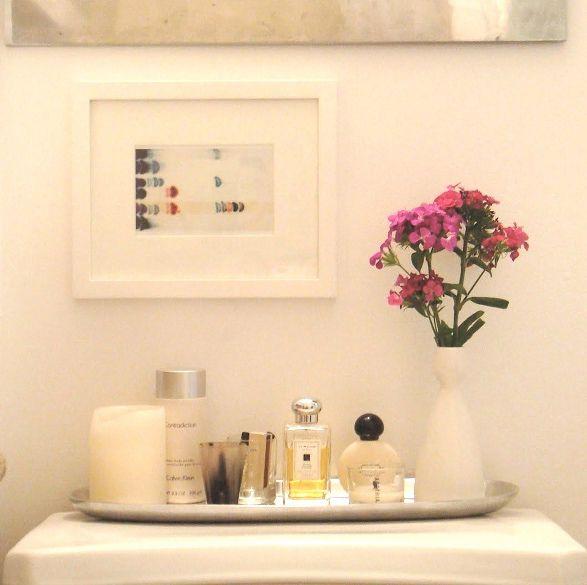 dress up knicknacks with a tray 15 DIY Bathroom Storage Ideas | StyleCaster