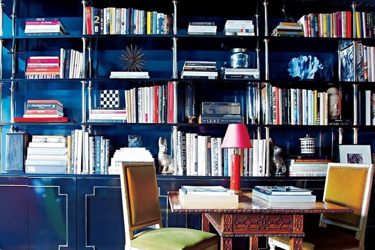 Temper Chicness With Usability  This library, lacquered in midnight blue, features ebony bookshelves with nickel supports. A well-placed reading table makes the room both lovely and practical.  - Place a reading table to make the room practical yet chic. - design advice from Miles Redd advice #6 of 6