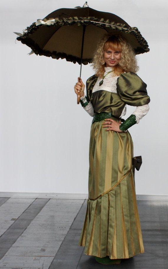 Long A-line stripped gold and green skirt with pleat on the bottom and big bow on back. Skirt is made of high quality light polyester and the bow is made of taffeta. Perfect for elegant stylisations, costumes and even for everyday outfit! Dimensions: Waist: pas 72cm/28 Length: 111cm/44  Blouse from first photo on another listing