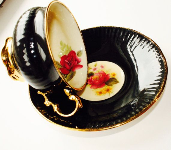 If you buy two teacups your second ships for free Contact me first so I can edit shipping options Clear the tea cart this ones a showstopper ! Gorgeous silky black accented handle with gold pedestal style gold gilding trim Inside hand-painted beautiful pink rose in a cream background