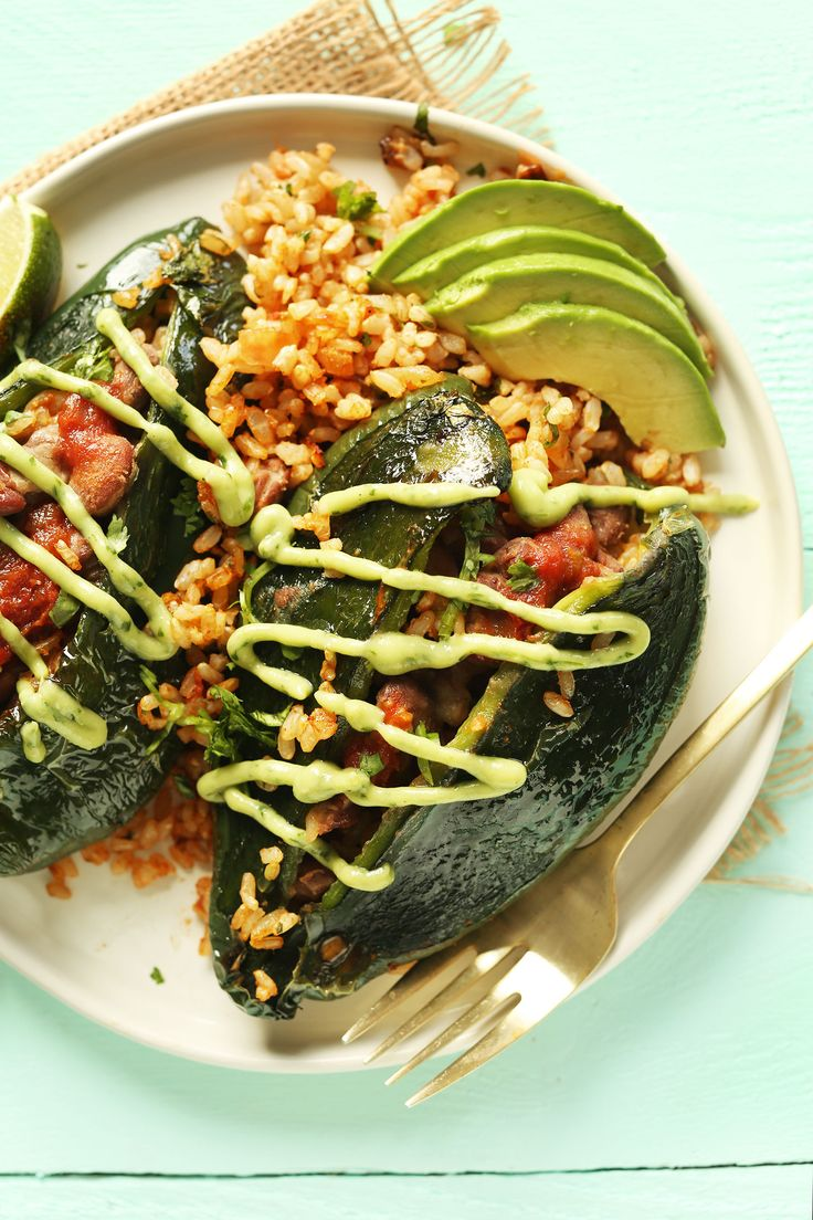 Easy, 10-ingredient Vegan Stuffed Poblano Peppers with brown rice, pinto beans, and a simple avocado crema! A healthy, flavorful, plant-based meal.