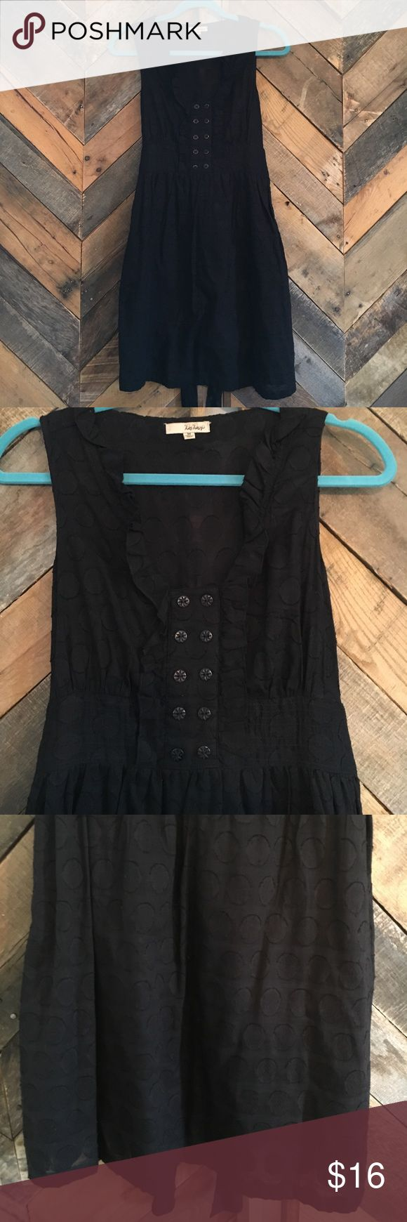"""Be Bop Black Dress Black 100% cotton sundress. Light and airy with a dot textured material. Super cute & flattering. Labeled a M but fits like a S/M. Has a fun button detailing and slight ruffle at the bust and down the front. Wish I could still fit into this! Skirt is fully lined. Bodice and top material is sheer-ish making it lightweight but you don't actually need to wear anything underneath as it's not see through. Is casual but can be dressed up! Hits just above the knee. Bust 18""""…"""