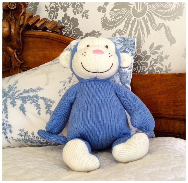 Beautiful blue knitted monkey, the perfect new baby gift!